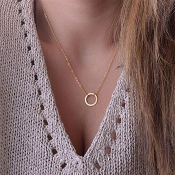 Golden necklace with round pendant